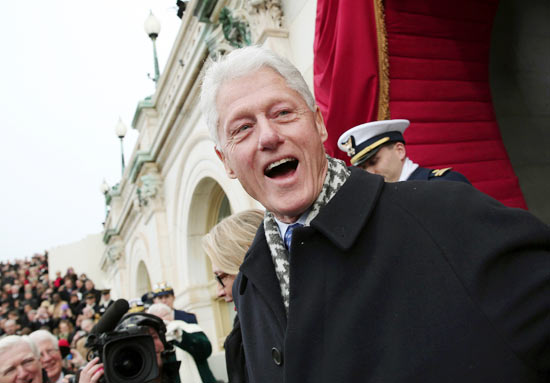 Former U.S. President Bill Clinton arrives for the presidential inauguration on the West Front of the U.S. Capitol in Washington January 21, 2013.