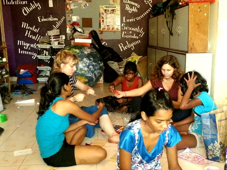 The flat from which Kranti operates. Seen here are German volunteers teaching the girls to sketch, paint and sculpt.