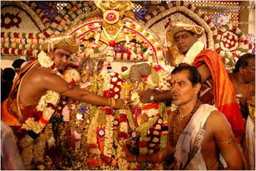 Pandits perform the celestial marriage in Madurai's Meenakshi Amman temple