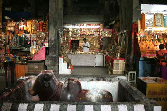 Shops selling idols and accessories inside the temple  make good profits this season