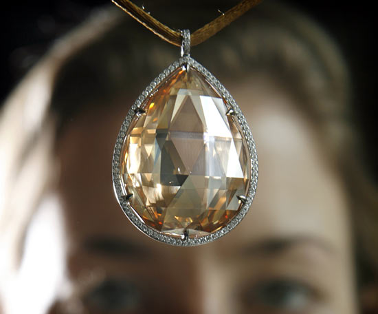 Christie's Jewellery specialist Helen Molesworth holds up a coloured diamond pendant during an auction preview in Geneva May 11, 2007.
