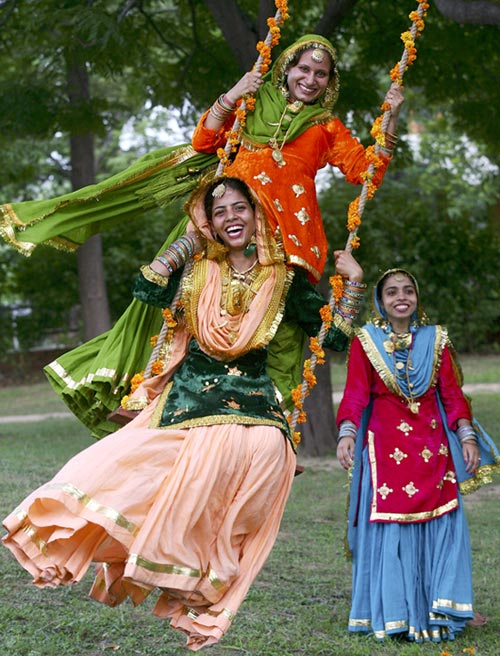 Women celebrate the festival of Teej in Chandigarh.