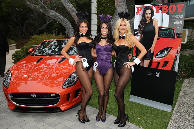 Playboy Playmate of the Year 2013 Raquel Pomplun (centre)
