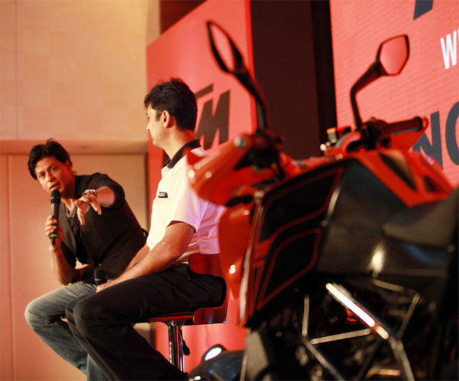 Shah Rukh Khan with Bajaj Auto MD Rajiv Bajaj