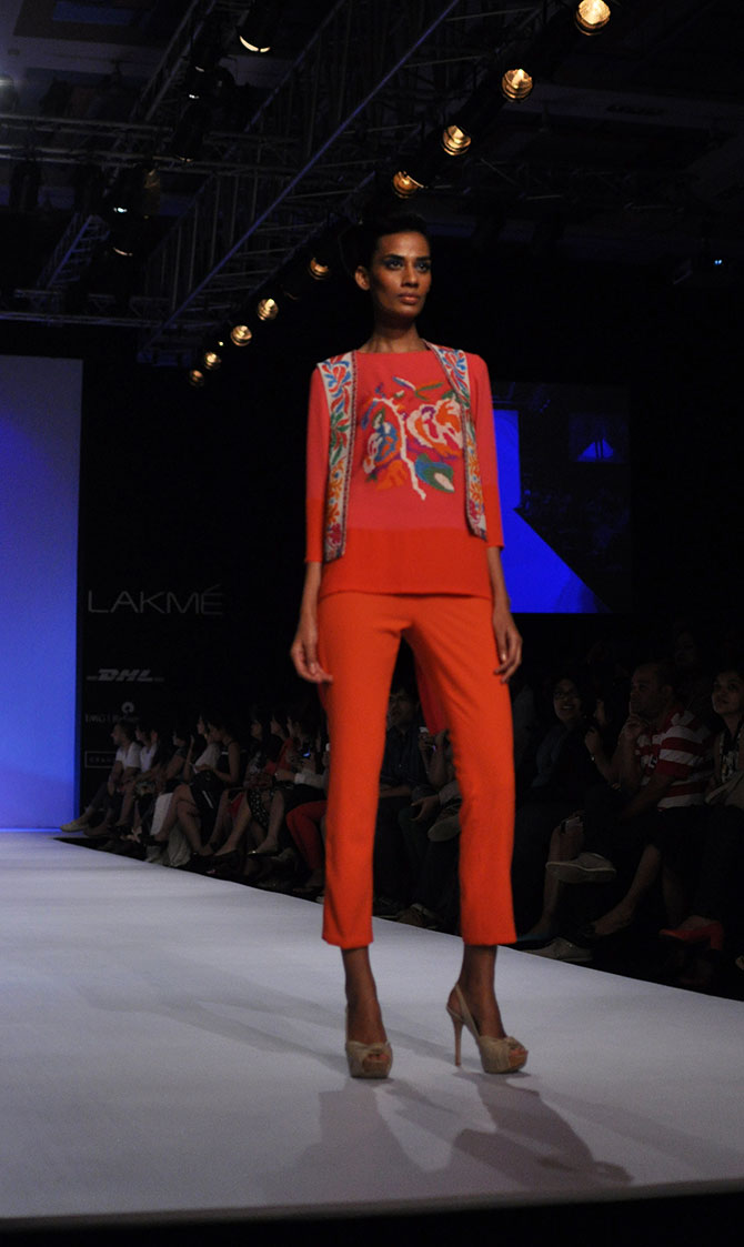 Sony Kaur in an orange western outfit by Ranna Gill