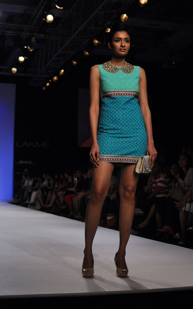 A model walks in a cobalt blue number by Ranna Gill