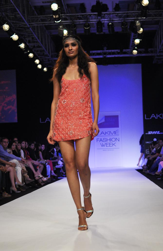 A model presents a cocktail dress by Anushka Khanna