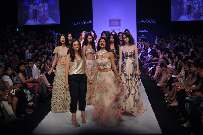 Designer Shehlaa Khan takes a bow with showstopper Jacqueline Fernandez .
