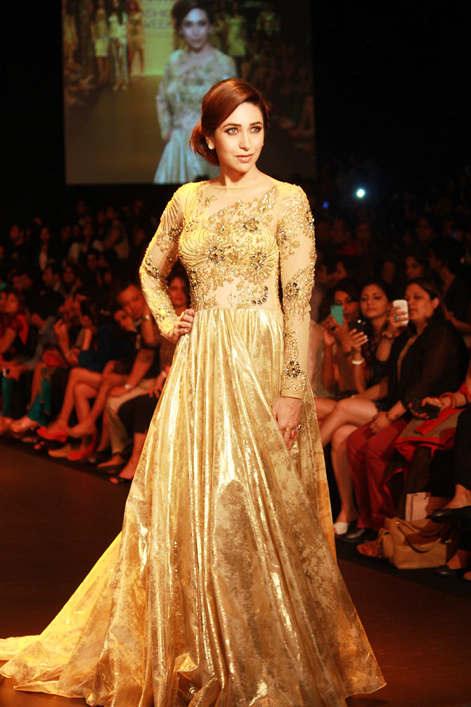Karisma Kapoor walks the ramp for Vikram Phadnis