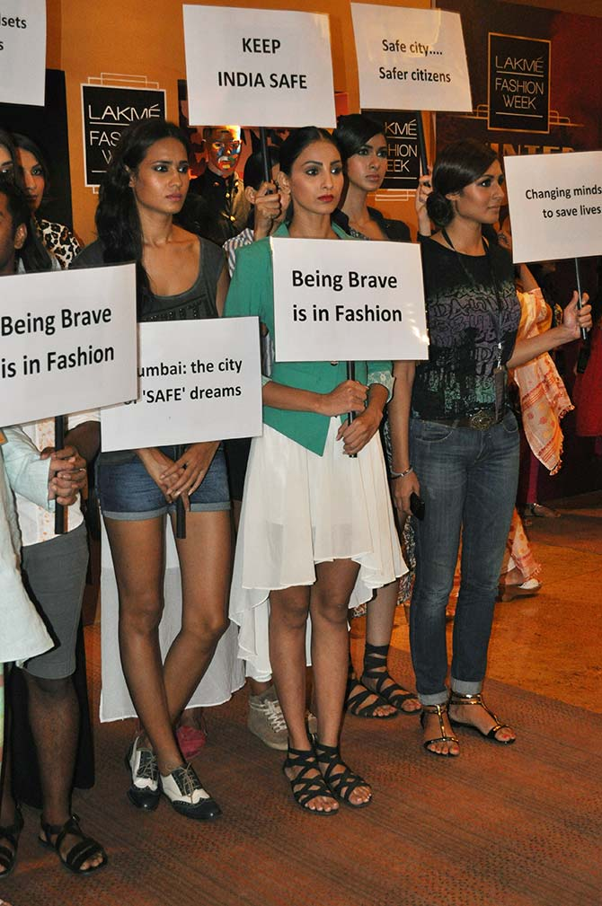 Models hold out placards to protest against the Mumbai rape at the ongoing Lakme Fashion Week