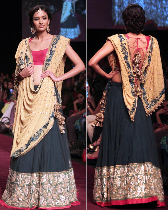 A model showcases a Shyamal and Bhumika creation.