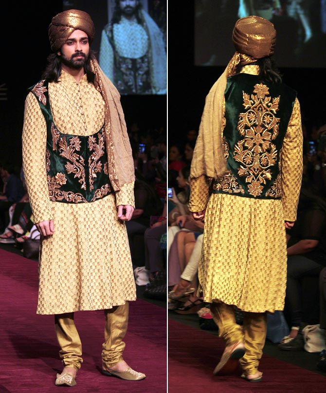 Model Amit Ranjan showcases a Shyamal and Bhumika creation.