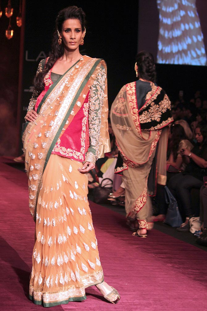 Model Kavita Kharayat showcases a Shyamal and Bhumika creation.