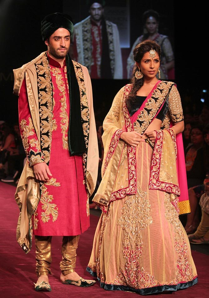 Models showcase a Shyamal and Bhumika creation.