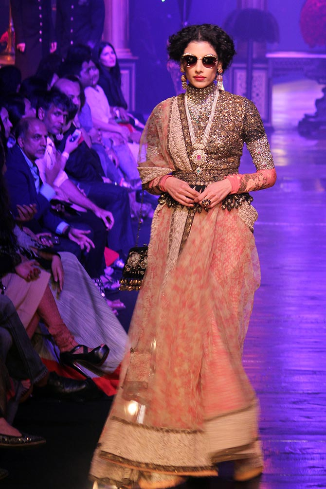 Indrani Dasgupta walked the runway for Sabyasachi Mukherjee in a luxurious crystal choli and a pair of sunglasses for his latest show at the Lakme Fashion Week