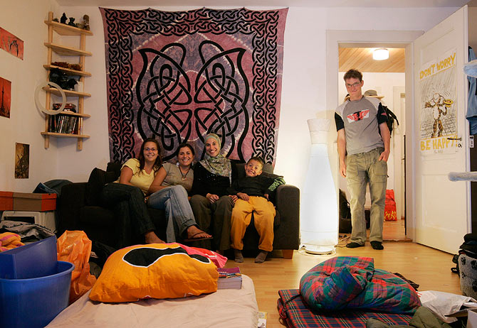 Thousands of people couchsurf every day. Seen here is Rafeal Nussbaum (R) from Switzerland as poses with his couchsurfing guests Renee Miller from US, Elena Tedeschi from Italy, Stephanie Ladel and Oussama Refas from France (L-R) at his apartment in Bern in this file photo.