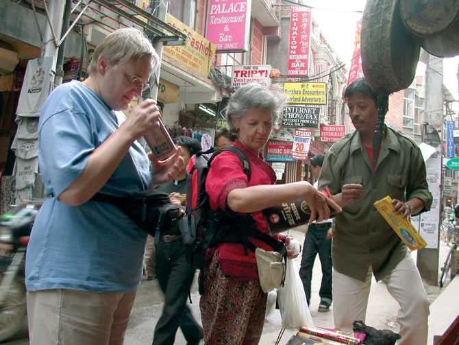 German tourists buy souvenirs at Thamel market in Kathmandu.