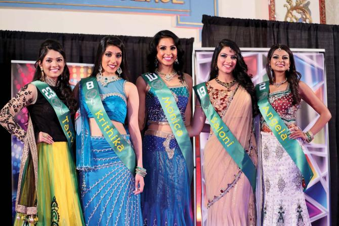 Winner Monica Gill, center, and first runner-up Angela Nand, right, with others who figured among the top five at the Miss India USA pageant held at the Royal Alberts Palace in New Jersey, November 24.