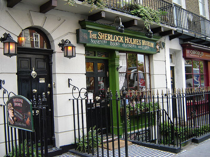 Photo showing the address as 221B beside the location of the Sherlock Holmes Museum in London