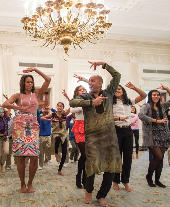 Michelle Obama shows off her moves in a Bollywood dance clinic session, featuring Nakul Mahajan and school students, in the White House's State Dining Room, November 5.