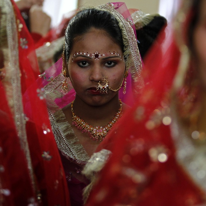 Nandini Krishnan's book explores the dynamics of arranged marriages in today's times. Pictured here are bejewelled brides at a mass marriage ceremony at Noida.