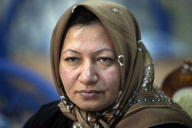 Sakineh Mohammadi Ashtiani, an Iranian woman sentenced to death by stoning, during a meeting with her son Sajjad Ghaderzadeh in Tabriz, 633 km northwest of Tehran, January 1, 2011. She had been accused of adultery and of being complicit in her husband's murder, but her sentence to be stoned to death was suspended after an international outcry.