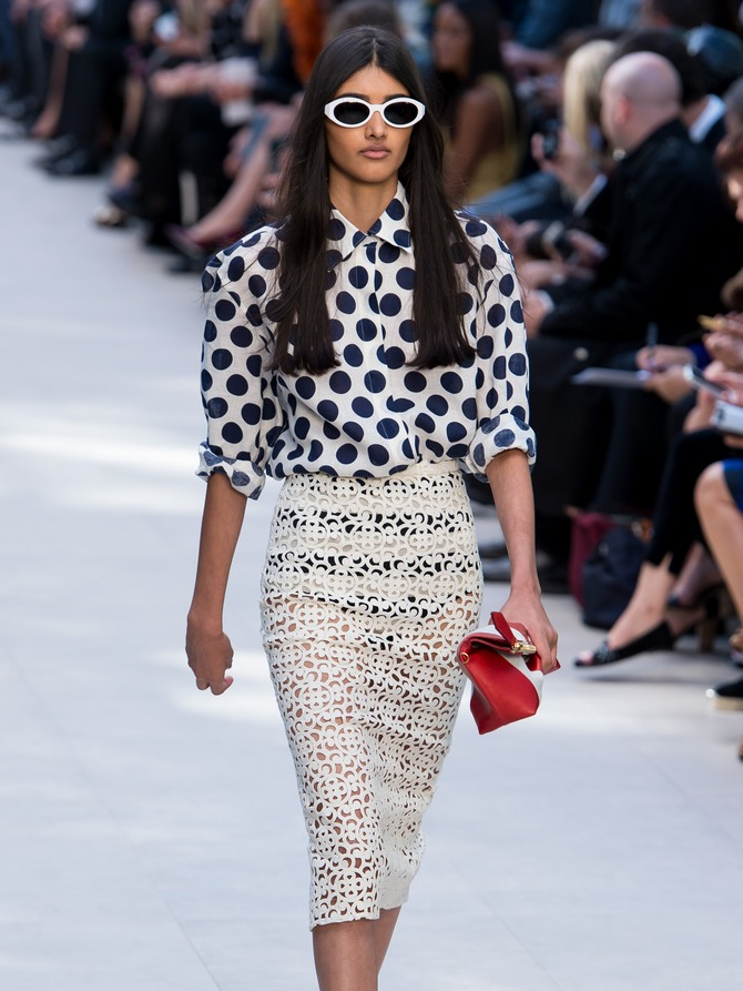 Neelam Johal walks the runway at the Burberry Prorsum show at London Fashion Week SS14 at Kensington Gardens on September 16, 2013 in London, England.