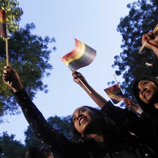 Gay rights activists wave flags as they attend a protest against a verdict by the Supreme Court in New Delhi. (Inset) Sunil Menon is a well-known gay rights activist and the founder of Sahodara