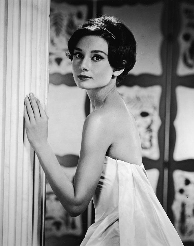 Portrait of Belgian-born American actress Audrey Hepburn (1929 - 1993) as she looks over her shoulder in a doorway, early 1950s.
