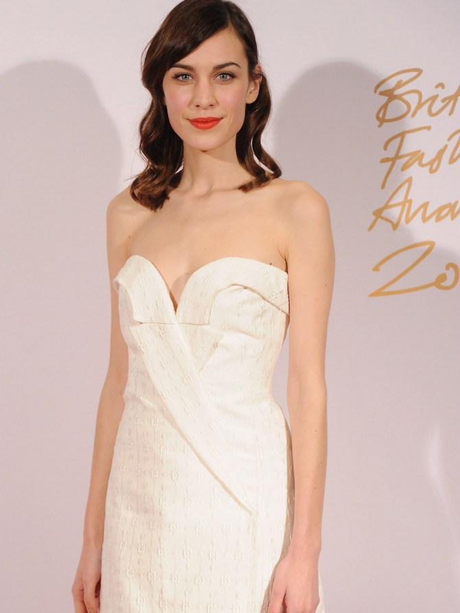 Alexa Chung poses in the winners room at the British Fashion Awards 2013 at London Coliseum.
