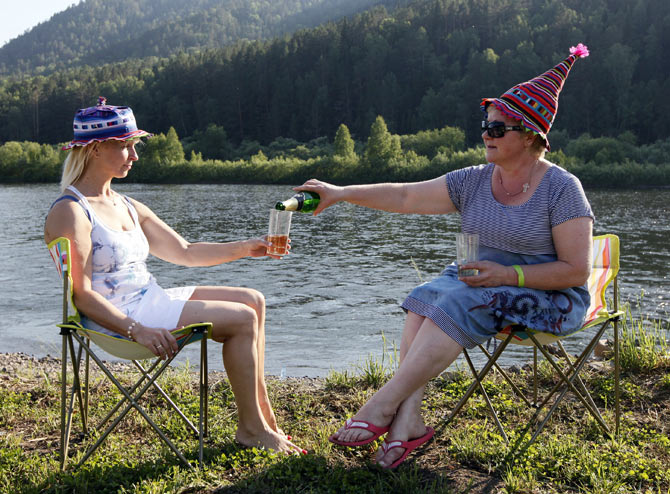 Two Russian women celebrate over champagne; Image for representational purposes only