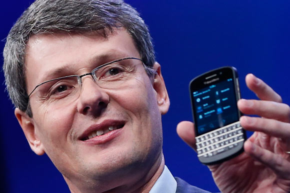 Research in Motion (RIM) President and Chief Executive Officer Thorsten Heins raises his arms during the launch of the RIM Blackberry 10 devices in New York January 30, 2013.