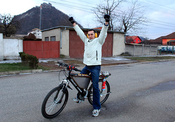 Raul Oaida poses with his bicycle propelled with a self-built jet engine inside a workshop before a road test in the back of his house in Deva, 399 km (245 miles) of Bucharest.