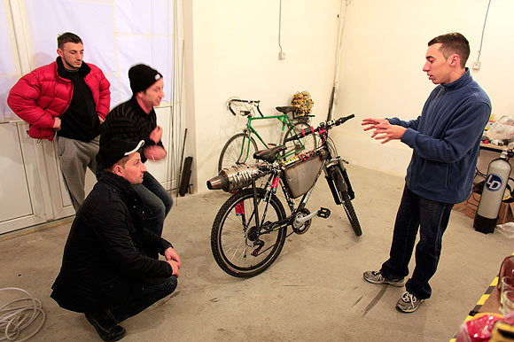 Raul Oaida prepares his bicycle propelled with a self-built jet engine for a road test in Deva, 399 km (245 miles) of Bucharest.