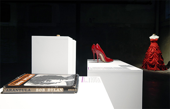 Articles including a book of poetry by Bob Dylan, red high heels and a wedding dress are displayed at the Museum of Broken Relationships.