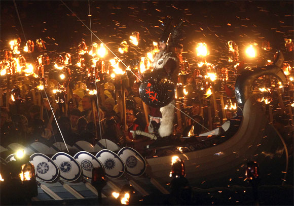 Guizer Jarl Stephen Grant stands on a viking longboat before it is sent on fire during during the Up Helly Aa fire festival in Lerwick, Shetland Islands, Scotland