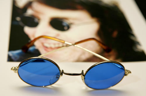 John Lennon, born on October 9, 1940, whose sunglasses are seen here alongside his photographs was among the famous people to be born in the year of the Dragon