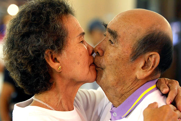 IN PICS: Couples lock lips to break record