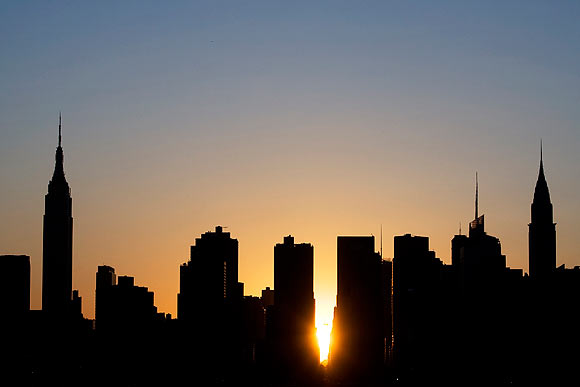 The sun sets over Manhattan aligned exactly with the streets in a phenomenon known as 'Manhattanhenge'