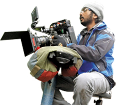 Sanu Varughese instructs his crew during an outdoor shoot