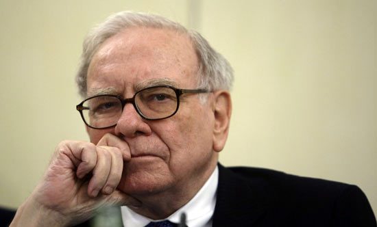 U.S. Investor Warren Buffett listens to a question during a news conference