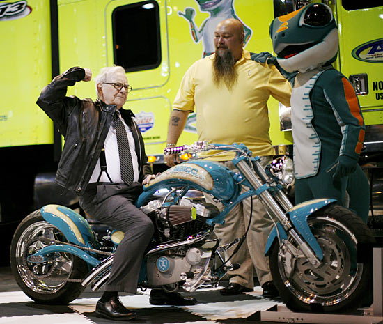 Billionaire financier and Berkshire Hathaway Chief Executive Warren Buffett poses on a motorcycle during the Berkshire Hathaway Annual Shareholders meeting in Omaha, Nebraska