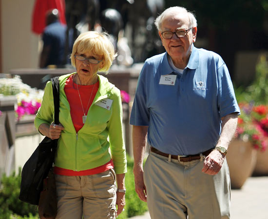 Berkshire Hathaway chairman and CEO Warren Buffett (R) and his wife Astrid Buffet walk to lunch during a break on the first day of the Allen and Company Sun Valley Conference in Sun Valley, Idaho