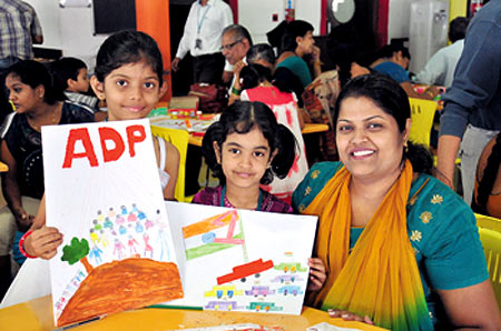 Employees and their families attend a greeting card design workshop