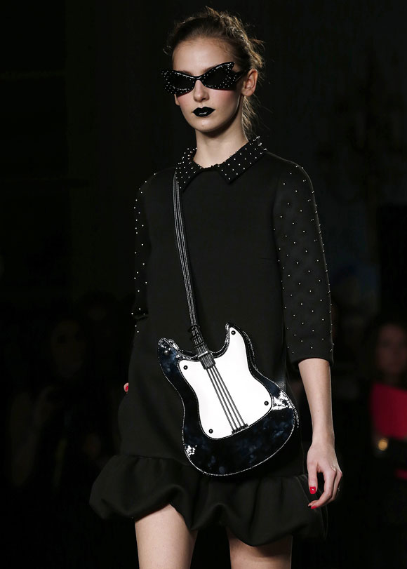 Moschino Cheap and Chic used studs and dark lip colour to heighten the Goth effect.