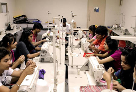 Students at JD Institute of Fashion & Technology in sewing class