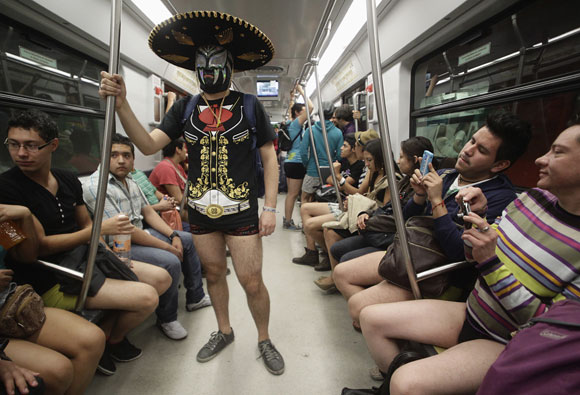 A participant of the No Pants Subway Ride stands in a subway train in Mexico City January 13, 2013