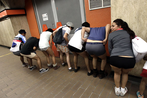 Participants of the No Pants Subway Ride pose for a photo as they wait for the train in Mexico City January 13, 2013
