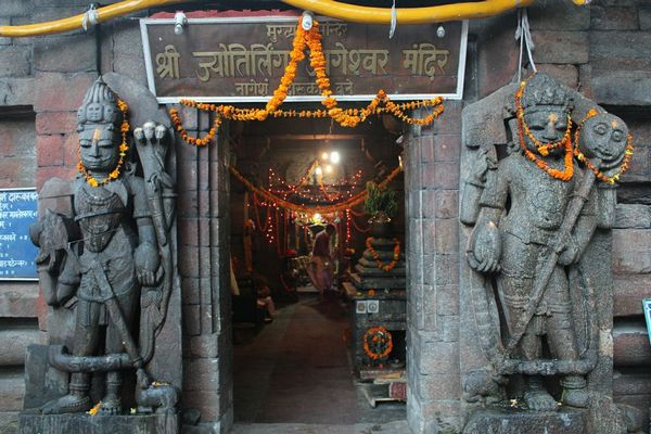 Entrance to Jageshwar Jyotirling. Dwarpals or door-keepers have a different looks from what I have seen in other temples.