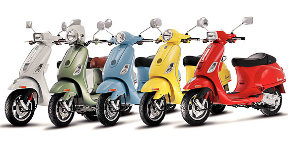 piaggio vespa two wheeler white green blue yellow red